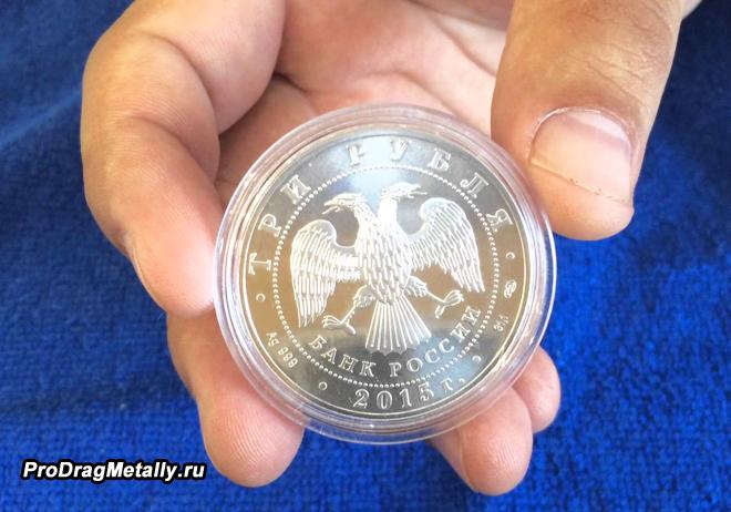 Монета Сбербанка в упаковке